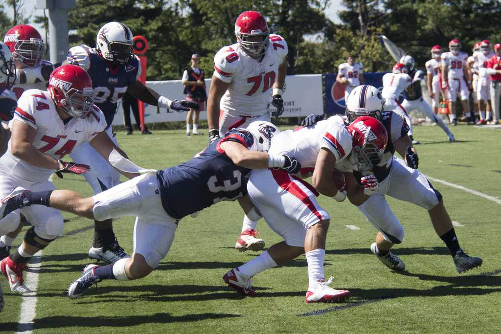 Cook (31) making one of his 19 tackles in RMU's 21-14 loss to Dayton