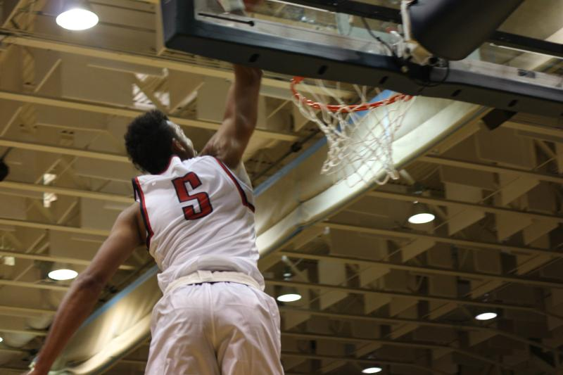 Elijah Minnie's double-double performance of 23 points and eight rebounds wasn't enough for the Colonials to defeat the Duquesne Dukes Saturday.