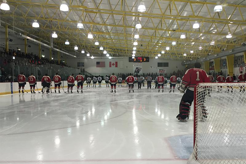 A+packed+84+Lumber+Arena+crowd+looks+on+as+players+line+up+for+the+National+Anthem+before+RMU+vs.+Mercyhurst.