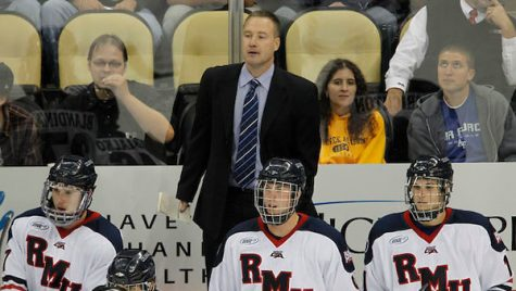 Robert Morris head coach Derek Schooley. RMU men's hockey vs. Air Force at PPG Paints Arena. Photo by Jason Cohn from USCHO.com