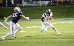 Terence Stephens runs against Duquesne. Photo credit: David Auth