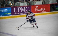 MOON TOWNSHIP -- Michael Louria heads up the ice against Niagara on  November 2, 2018 (David Auth/RMU Sentry Media