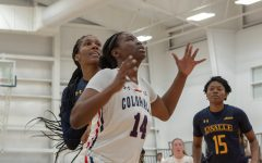 Irekpitan Ozzy-Momodu boxes out her opponent while attempting to get a rebound in the Colonials win against La Salle.