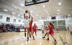 Nneka Ezeigbo makes a play at the rim in the team's 64-46 over Sacred Heart on Jan. 28, 2019 (Tim Kelly/RMU Sentry Media). Ezeigbo became the 23rd player in program history to grab 500 rebounds in the contest.