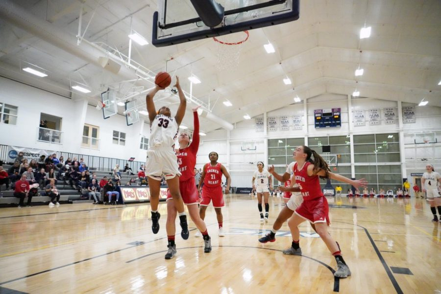Nneka Ezeigbo makes a play at the rim in the teams 64-46 over Sacred Heart on Jan. 28, 2019 (Tim Kelly/RMU Sentry Media). Ezeigbo became the 23rd player in program history to grab 500 rebounds in the contest.