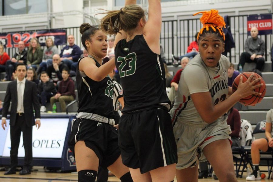 MOON+TOWNSHIP+--+Nneka+Ezeigbo+looks+to+drive+to+the+hoop+against+Wagner+on+January+26%2C+2019+%28Michael+Sciulli%2FRMU+Sentry+Media%29.+Eziegbo+had+a+career+night+as+she+finished+with+a+double-double+of+13+points+and+17+rebounds.+Photo+credit%3A+Samuel+Anthony