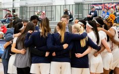 The RMU Women's Basketball team huddles up during the media timeout. Moon Twp, PA Jan. 28, 2019. (RMU Sentry Media/Samuel Anthony)