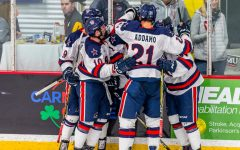 PITTSBURGH -- The Robert Morris Colonials celebrate after a goal against Bowling Green (David Auth/RMU Sentry Media).