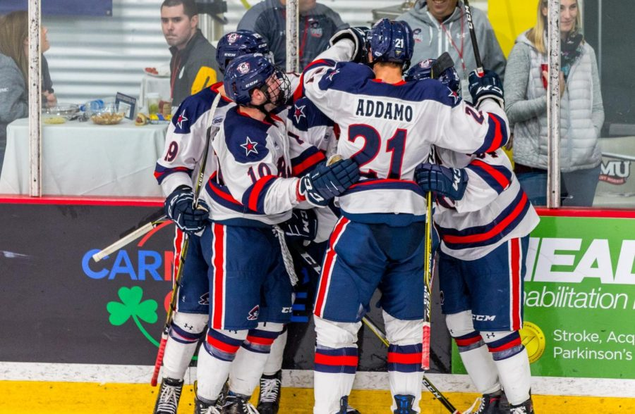 PITTSBURGH+--+The+Robert+Morris+Colonials+celebrate+after+a+goal+against+Bowling+Green+%28David+Auth%2FRMU+Sentry+Media%29.