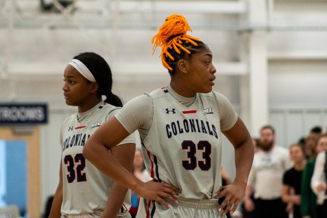 MOON TOWNSHIP -- Nadege Pluviose (left) and Nneka Eziebo (right) take a break during the game against Wagner on January 26, 2019 (Samuel Anthony/RMU Sentry Media)