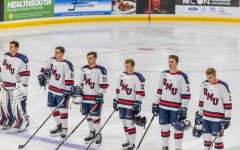 PITTSBURGH -- The men's hockey team stands for the national anthem against Bowling Green on 10/12/18 (David Auth/RMU Sentry Media).