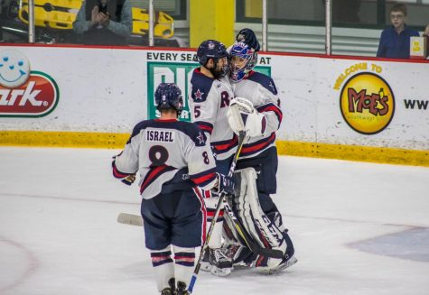 PITTSBURGH -- The Colonials celebrate a victory over RIT (David Auth/RMU Sentry Media).
