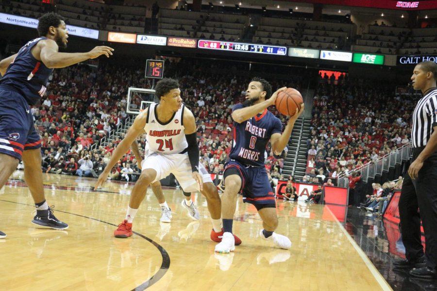 Josh+Williams+looks+to+pass+against+Louisville