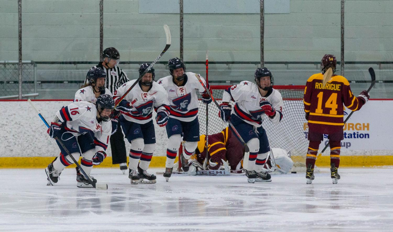 Women's hockey signs three