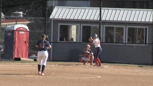 Rachael Rhinehart (27) deals to Natalie Higgins (26) before one of her two home runs