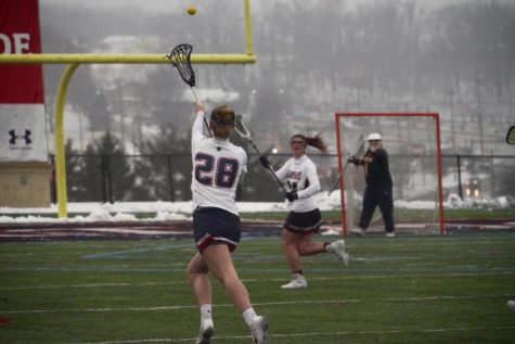 Hannah Miller (28) was named one of women's lacrosse's co-captains for the upcoming season. Photo Credit - Tim Kelley