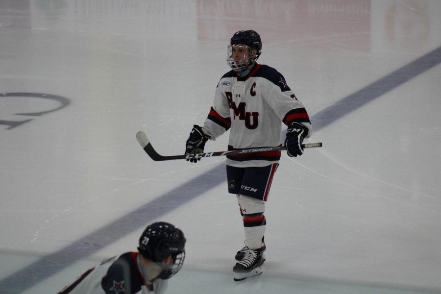 Nick Jenny scored a goal in men's hockey's 5-2 loss to Canisius in their AHA opener. Photo credit: Nathan Breisinger