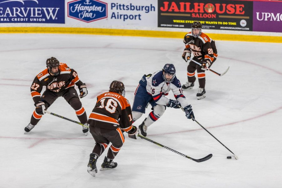 Nick+Prkusic+stick-handles+around+Bowling+Green+defenders+during+a+game+on+October+12%2C+2018%0A%0APhoto+credit+-+David+Auth