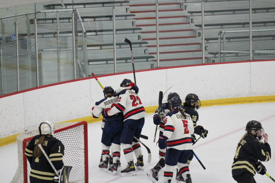 The Colonials celebrate Ellie Marcovsky's first career goal, the game-winning goal, on Friday night. Photo Credit: Nathan Breisinger