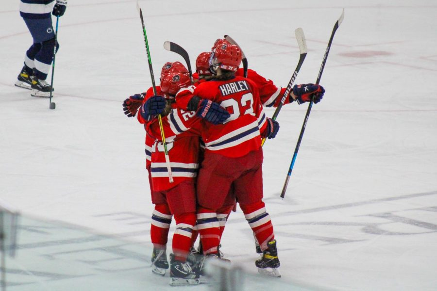 Women's hockey celebrates a goal against Penn State. They'll look to do more celebrating this weekend against RIT. Photo Credit: Nathan Breisinger