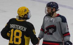 Sean Giles shakes Blake Christensen of AIC's hand. Giles signed with Knoxville of the SPHL this week. Photo Credit: Garret Roberts