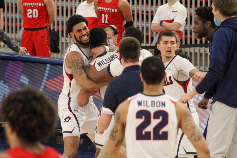 Jon Williams is embraced by AJ Bramah as they celebrate one of his two buzzer-beaters on the night. Photo Credit: Tyler Gallo