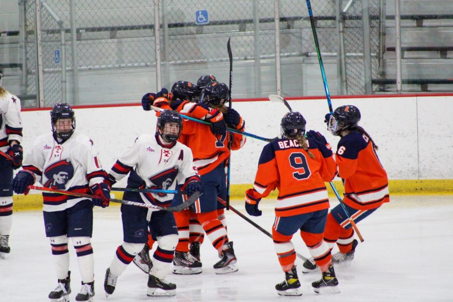 The Orange celebrate Sara Thompson's goal in the second period, the first of four-straight the Orange would score. Photo Credit: Tyler Gallo