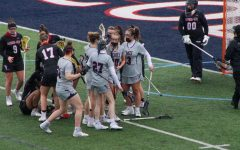 The women's lacrosse team celebrates Melanie Gandy's second-half goal on Sunday, one of her seven points. Photo Credit: Tyler Gallo