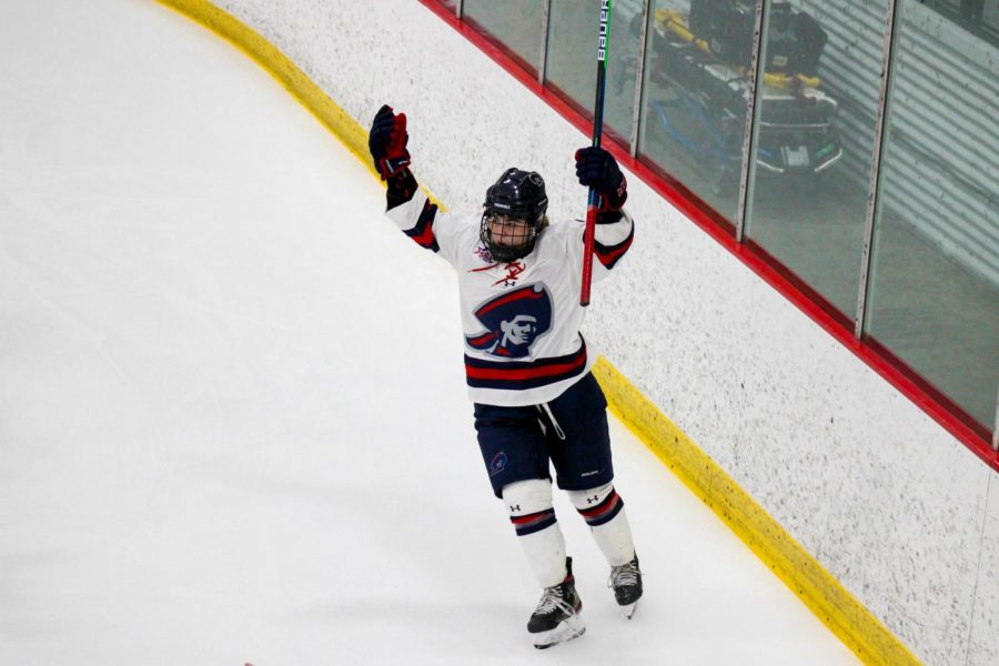 Michaela Boyle celebrates one of her four goals on Sunday as the Colonials dismantled Sacred Heart 8-0. Photo Credit: Nathan Breisinger