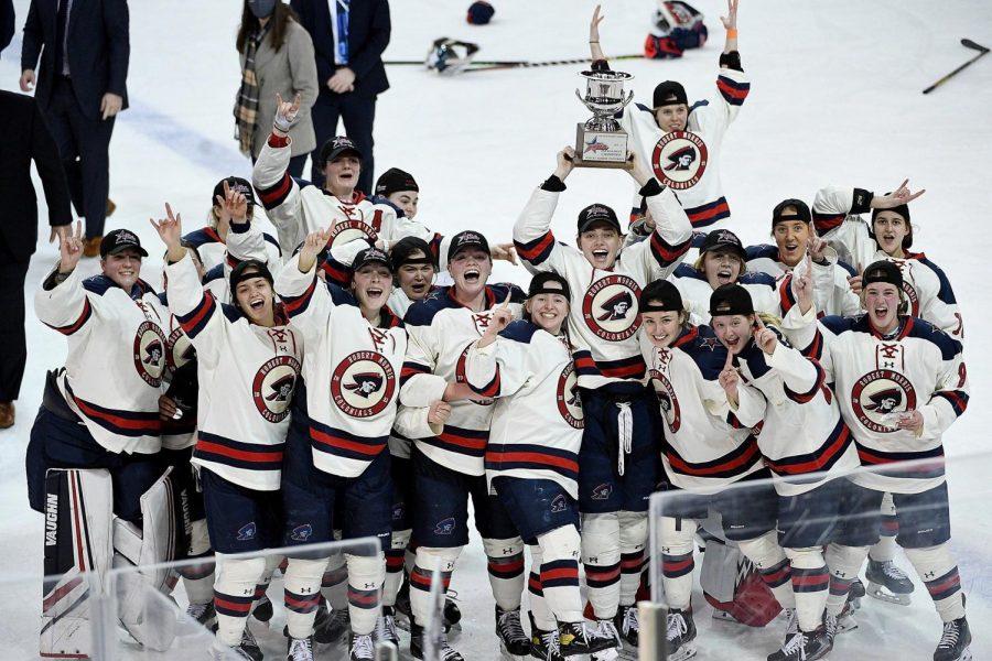 Women's hockey celebrates its championship. Photo Credit: Justin Berl