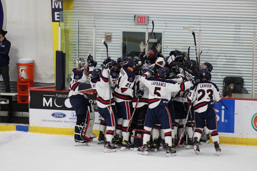 Men's hockey celebrates a regular-season win over Niagara, looking to do the same this weekend. Photo Credit: Nathan Breisinger
