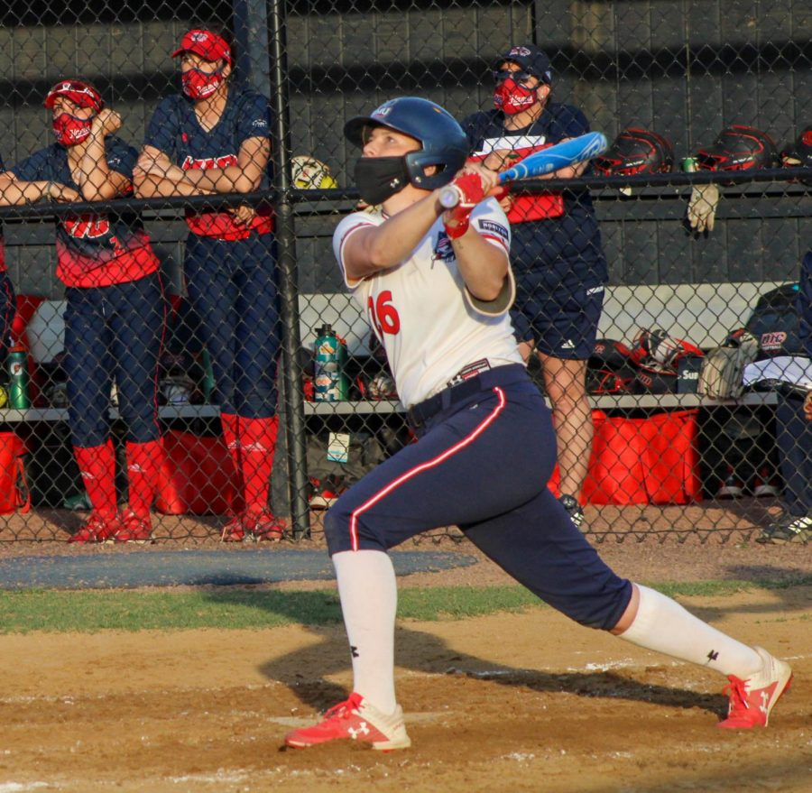 Natalie Higgins takes a swing against UIC. Photo Credit: Tyler Gallo