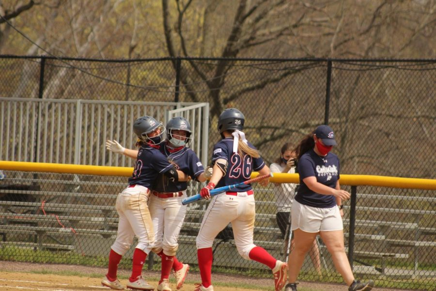 The Colonials celebrate Faith Miller's walk-off single in the first game of the Saturday doubleheader. Photo Credit: Ally Yovetich