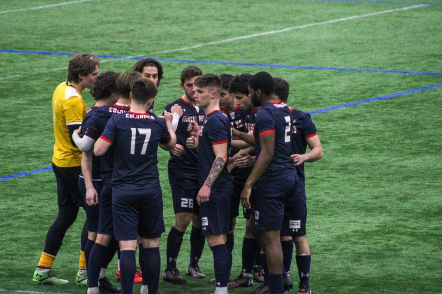 Mens soccer huddles up before taking the field. Photo Credit: Tyler Gallo/Colonial Sports Network