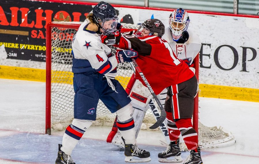 Kirsten Welsh polices the crease against St. Lawrence on September 28, 2018