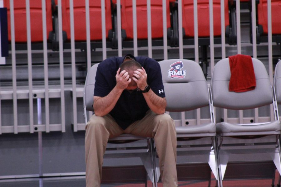 Head coach Dale Starr puts his head down in disgust after the Colonials blew a late lead in their third set.
