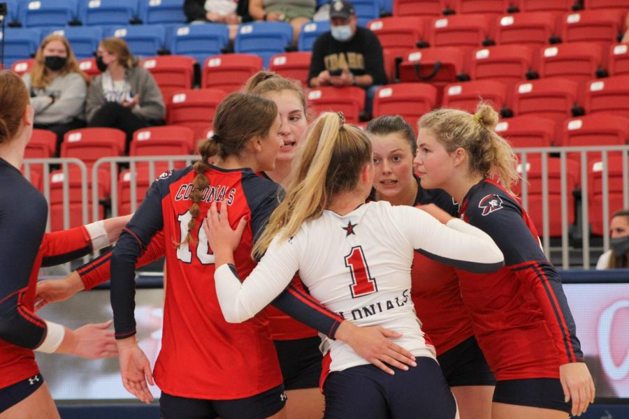 RMU Volleyball comes together after a point for Idaho.