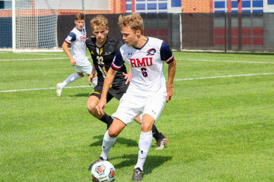 Gustaf Moberg carries the ball against Milwaukee.