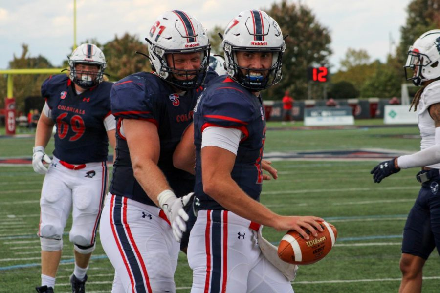 George+Martin+smiles+after+his+two-point+conversion+to+put+the+Colonials+up+six+late+in+the+fourth+quarter.