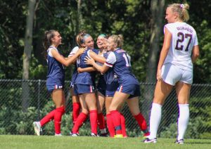 Women's soccer celebrates a goal against Valparaiso.