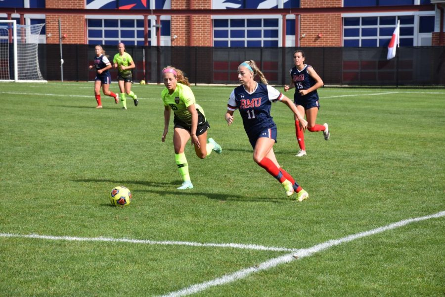 Sheridan Reid and Sydney Grodsinsky chase after the ball.